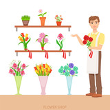 Male Florist In The Flower Shop Demonstrating The Assortment