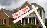 Foreclosure sign in front on modern house