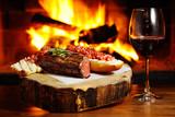 tasty steak on a background of fire