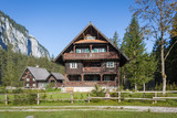 Wooden hunting lodge in the forest - 124935685