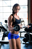 Fitness Model in Gym Working Out 2
