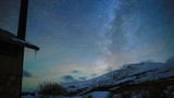 Milky Way timelapse over snow-capped mountain