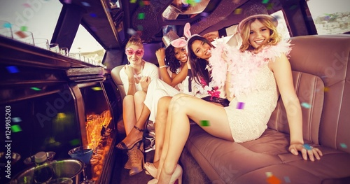 Composite image of portrait of female friends in limousine