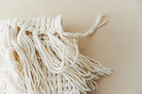 warm White knit scarf with tassels. Close