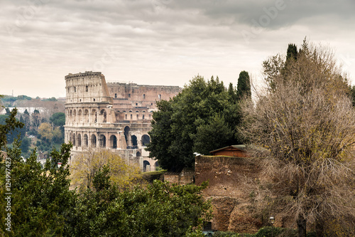 Foto op Canvas Mediterraans Europa Roman ruins and the Colosseum in Rome, Italy