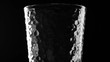 Water pour into transparent glass on the black background