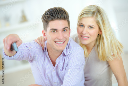Poster couple with remote