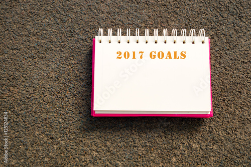 Book write 2017 goals on road background