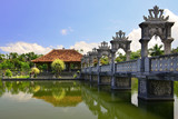 Bali, Indonesia. View of the Taman Ujung Water Palace, surrounded by a pond and garden