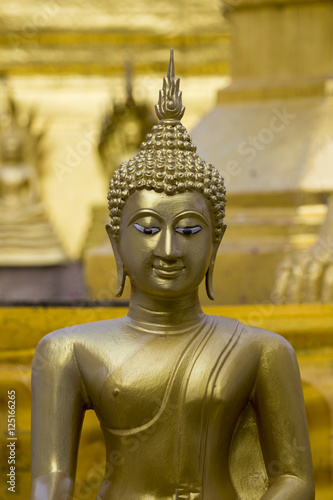 Poster, Tablou Image of golden buddha statue in temple in province tak. Thailand