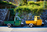 Two Piaggio Ape trikes / Green and yellow mini cars