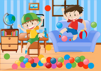 Two boys playing ball in the room
