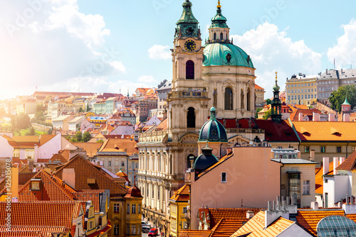 Poster Cityscape view on the lesser town with saint Nicholas church in Prague city