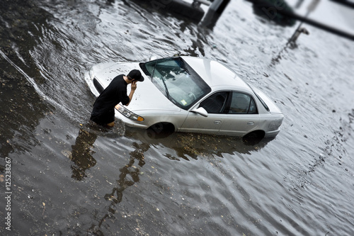Flood Insurance concept image with unrecognizable person stuck in flood waters.