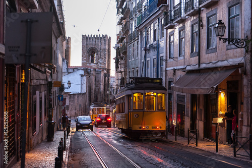 Poster Tram car crossing street at evening in Lisbon, Portugal