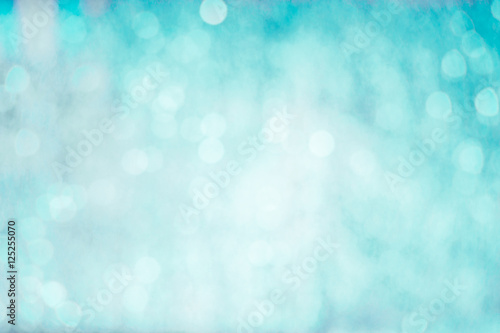 Turquoise blue background with bokeh