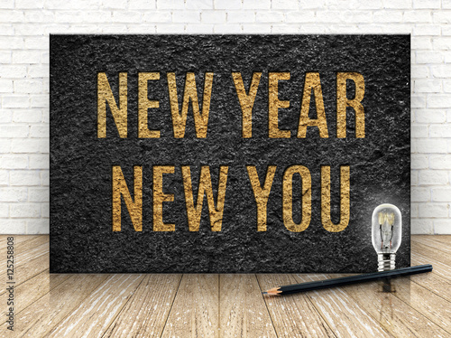 Inspiration quote,New year new you word with lightbulb and penci Poster