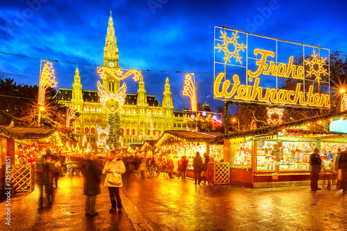 Traditional christmas market with 'Merry Christmas' sign in Vienna, Austria Poster