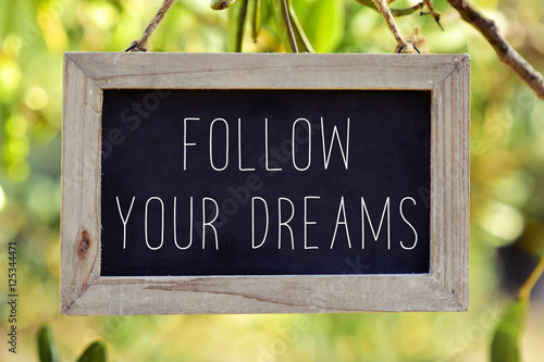 Poster chalkboard with the text follow your dreams