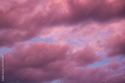 Aluminium Colourful skyscape with purple clouds at sudown dusk