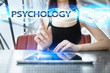 Постер, плакат: Woman is using tablet pc pressing on virtual screen and selecting psychology
