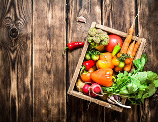 Healthy food. Organic vegetables in an old box.
