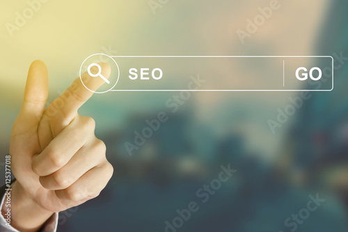 Poster business hand clicking SEO or Search engine optimization button