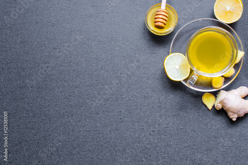 Poster transparent cup of green natural tea with ginger, lemon and honey