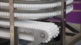 Conveyor belt transporatation system movement close up