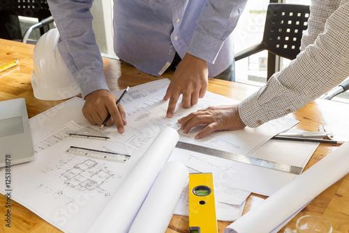 architect point at blueprint, architectural concept