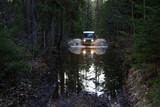 Jeep  on the river Luga - 125422297