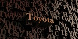 Toyota - Wooden 3D rendered letters/message.  Can be used for an online banner ad or a print postcard.