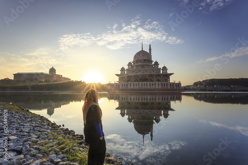 Malaysia travel - Putrajaya Mosque with Muslimah pray in Malaysi Poster