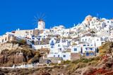 Traditional white architecture of Oia village, Santorini island, Greece - 125462055