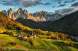 Quadro Santa Maddalena village in front of the Geisler or Odle Dolomites Group on sunset, Val di Funes, Italy, Europe.