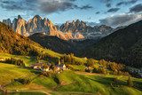 Santa Maddalena village in front of the Geisler or Odle Dolomites Group on sunset, Val di Funes, Italy, Europe.