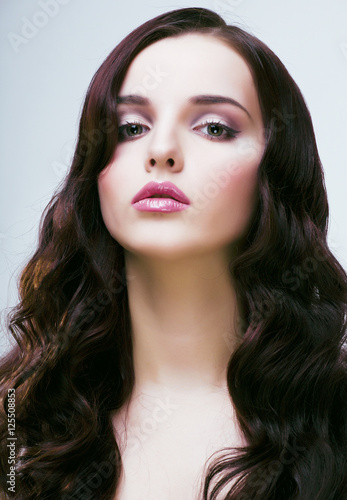 Poster young pretty woman with hairstyle waves, luxury look