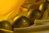 Christmas balls decoration on a yellow satin cloth