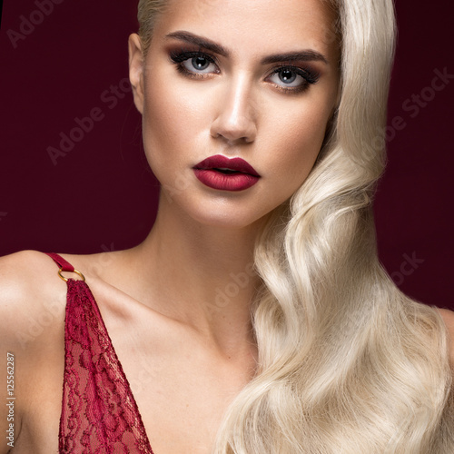 Poszter Beautiful blonde in a Hollywood manner with curls, red lips, red lingerie