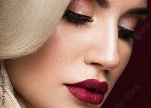 Poszter Beautiful blonde in a Hollywood manner with curls, red lips, red