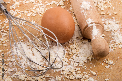 Poster ingredients and accessories to bake scottish oatmeal biscuits