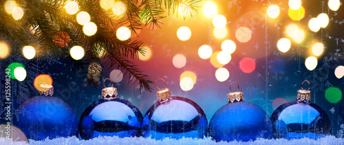 Blue Christmas; Holidays background with Xmas decoration  on sno