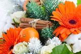 Christmas background with fresh flowers and fruit, close-up