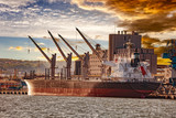 Cargo ship moored at the quayside in the port of Gdynia, Poland. - 125621679