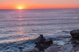 Sunrise on the coast of Escullos. Natural Park of Cabo de Gata. Spain.