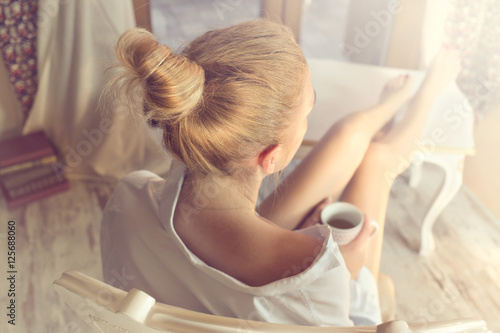 woman sipping coffee in a magic moment of quiet Poster