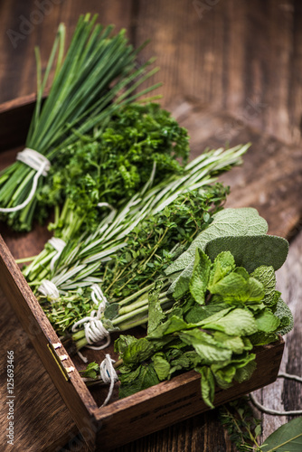 fresh aromatic herbs on kitchen table