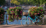 Classic bicycle parked on canal bridge, Amsterdam, Netherlands