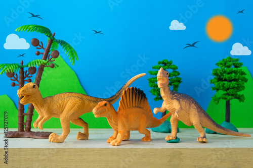 Dinosaur hunter on wild models background Poster