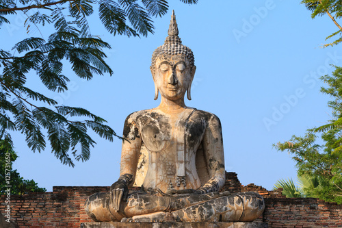 Poster Ancient buddha. Sukhothai Historical Park or Old Sukhothai City.